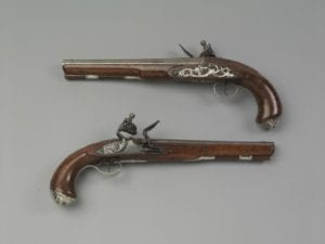 Pair of flintlock pistols, marked by Frederick Zorger (1734-1815), York, Pennsylvania; 1765-80. Maple, silver, iron. 1961.857.1,.2 Bequest of Henry Francis du Pont
