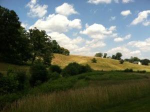 hill and farmhouse