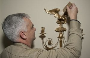 dusting a sconce