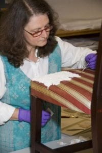 conservator works on stain reduction