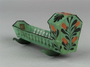 Green Amish rocking cradle with flower design