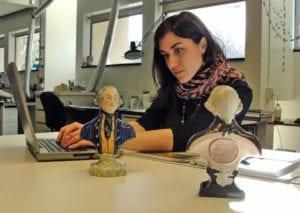 Lauren Fair surveying Staffordshire busts of George Washington