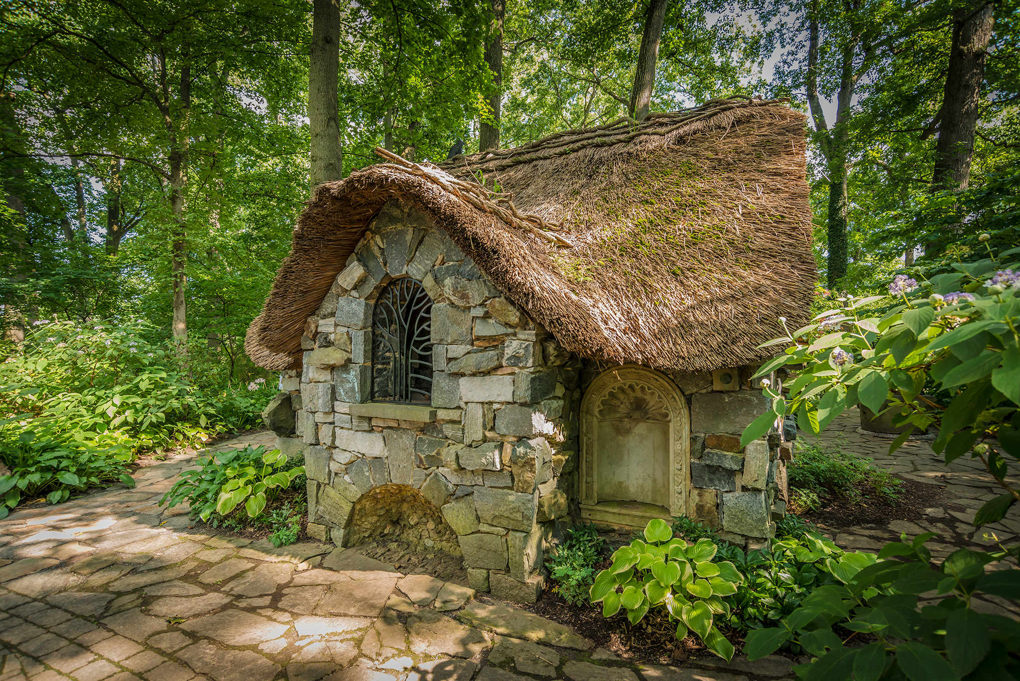 Faerie Cottage with a thatched roof in the Enchanted Woods.